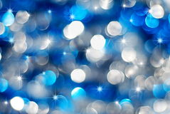 Indicatori luminosi d'argento e blu di festa fotografie stock libere da diritti
