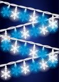 Indicatori luminosi del fiocco della neve Fotografie Stock Libere da Diritti
