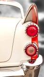 Indicatori luminosi della coda dell'automobile dell'annata immagine stock