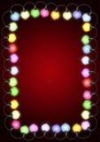Indicatori luminosi di natale sulla scheda Fotografia Stock