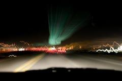 Indicatori luminosi di notte & la strada principale Fotografia Stock