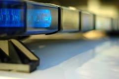 Indicatori luminosi infiammanti del volante della polizia Immagine Stock