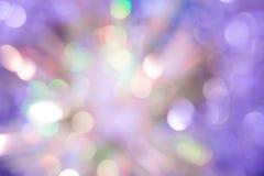 Indicatori luminosi su struttura blu di background Bokeh di festa Estratto Natale Festivo con defocused e le stelle Immagini Stock