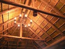 Indicatori luminosi in tetto del thatch Fotografia Stock Libera da Diritti