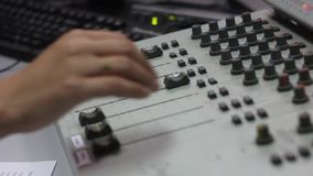 The indicators on the mixer. Digital mixing console with volume meter, volume indicator, closeup stock video footage