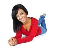 Indicazione sorridente della giovane donna Fotografia Stock