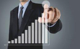 Indice crescente del mercato azionario di scrittura dell'uomo d'affari di doppia esposizione Fotografia Stock