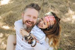 Indie style smiling couple, woman embracing man, hipster outfit, boho chic stock photography