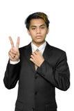 Indien d'homme d'affaires effectuant des jeunes du signe v Image libre de droits