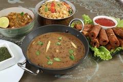 Indier Dal Makhani med Pulav eller grönsaken Pulao och Chana Masal royaltyfria bilder