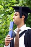 indier för kappaavläggande av examengrabb Royaltyfria Bilder