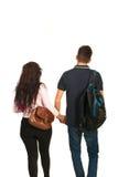 Indietro del banco andante delle coppie degli studenti Fotografie Stock