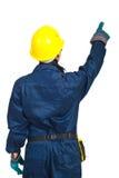 Indietro della donna dell'operaio che indica in su immagine stock libera da diritti
