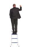 Indietro di scrittura dell'uomo di affari su una scala Fotografia Stock