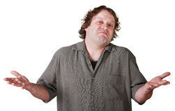 Indifferent Young Man. With palms up over white background stock photography
