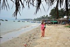 Indigene in Mui ne fishing village. A woman and her boy in mui ne fishing village vietnam royalty free stock image