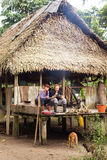 Indigenous Amazonia Hut. Tourist Having Lunch On Indigenous House Porch Royalty Free Stock Photos