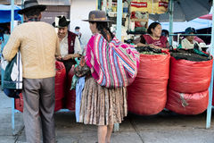 Indigenous Bolivian couple selling coca leaf at the market Stock Image