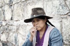 Indigenous Bolivian woman chewing coca leaf Stock Images