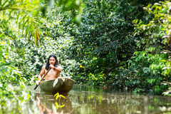 Indigenous Canoe Transportation Amazon. Indigenous Adult Man On Typical Wooden Canoe Chopped From A Single Tree Navigating Murky Waters Of Ecuadorian Amazonian Stock Images