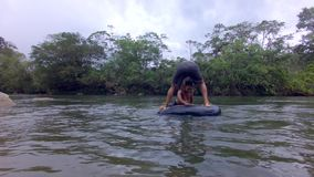 Indigenous Children Playing In A Floating Inner Tube. In Ecuador stock footage