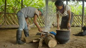 Tribe Man And Woman Cooking. Indigenous Cooking, Handicrafts And Art On Amazonian Village In Ecuador stock video footage