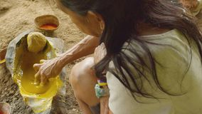 Tribe woman making paste. Indigenous cooking, handicrafts and art on amazonian village in Ecuador stock video