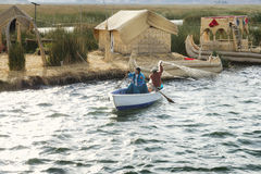 Indigenous couple from the Uros Islands fishing on Lake Titicaca Royalty Free Stock Photo