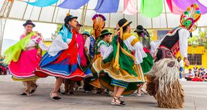 Indigenous dancers of Ecuador stock images