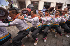 Indigenous dancers in the street in Pujili Ecuador Stock Image