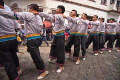 Indigenous dancers in the street in Pujili Royalty Free Stock Photography