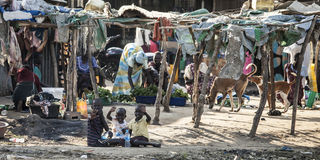 Indigenous displaced family, Bor South Sudan. BOR, SOUTH SUDAN-NOVEMBER 2: Unidentified children and families live a tenuous life of poverty in Bor, South Sudan Stock Photography