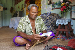 Indigenous Fijian man reads the bible in Fiji. Indigenous Fijian man reads the bible in his home in Fiji.  Fiji was Christianized in the 19th century. Today Royalty Free Stock Photo
