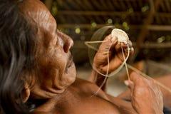 Indigenous Hammock Knitting. Amazonian Indigenous Huaorani Weaving Focus On Face Waorani Reserve Yasuni National Park Ecuador Royalty Free Stock Photo