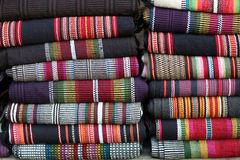 Indigenous handicraft. Indigenous shawls and blankets on a pile. Cottage industry production by women in CHT, Bandarban District Royalty Free Stock Photo