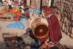 Indigenous Inca man selling souvenirs and playing drums, Chinchero market , Cusco, Peru Royalty Free Stock Photos