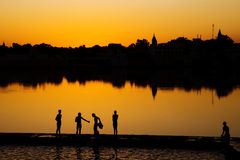 Indigenous Indian Boys Washing By The Lake Royalty Free Stock Photo
