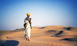 Indigenous Indian Man Playing Wind Pipe Desert Concept.  Stock Photo
