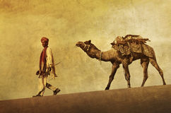 Indigenous Indian Man Walking Through The Desert With His Camel Royalty Free Stock Images