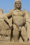 Indigenous indian sand sculpture. Sand sculpture of a proud indigenous indian, against a clear blue sky Royalty Free Stock Images