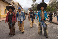 Indigenous kechwa men wearing chaps and oversized hats in Cotacachi Ecuador. June 24, 2017 Cotacachi, Ecuador: indigenous kichwa men wearing chaps at the Inti royalty free stock photo
