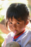 Indigenous little girl  with local traditional costume. CHIANGMAI, THAILAND - JANUARY 24, 2015: Indigenous little girl sucking coconut jiuice in 22nd Stock Photography