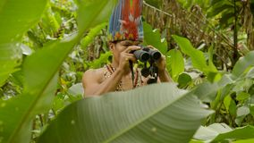 Indigenous Man With Binoculars. Seeing The Enemy'S Position In Ecuador stock video