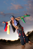 Indigenous man with ceremonial pole Stock Image