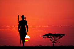 Indigenous man at sunset Stock Images