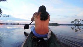 Indigenous Man On Wooden Canoe,