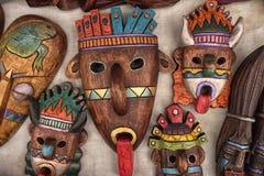 Indigenous masks made of wood. Otavalo, Ecuador- March 17, 2018: indigenous masks made of wood on display in the artisan market Stock Images