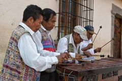 Indigenous maya men street musicians. February 14, 2015 Antigua Guatemala: indigenous maya men  marimba band performing on the street Stock Photography