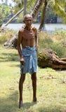 Indigenous old man walikng stick Kerala India Royalty Free Stock Photography