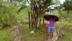 Indigenous Old Woman, Carrying A Plastic Cap Over Her Head. Indigenous Old Woman, Carrying A Big Plastic Cap Over Her Head In Indigenous Village In Ecuador stock footage